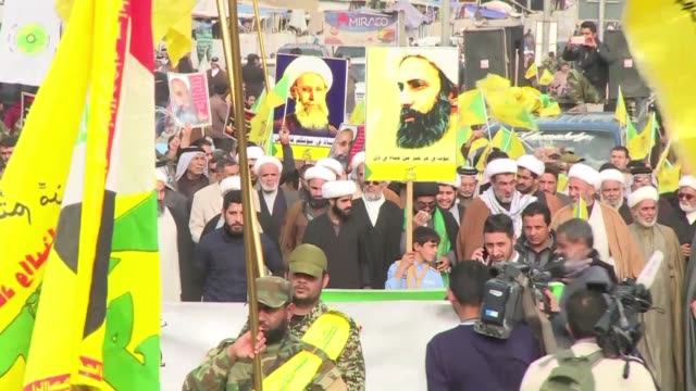 several thousands of shiite militia members and civilians protested against saudi arabia at tahrir square in central baghdad on wednesday - shi'ite islam stock videos & royalty-free footage