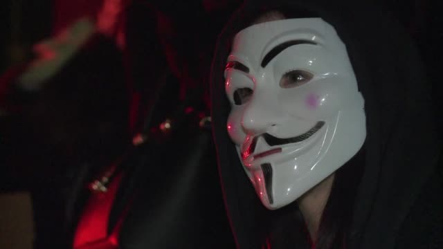 Several thousands of supporters of the Anonymous movement wearing masks march in the streets of London for the annual Million Mask March on Guy...