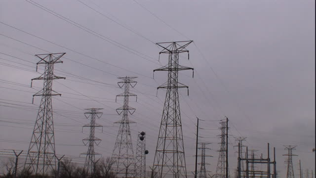 several transmission towers occupy a field. - communications tower stock videos & royalty-free footage