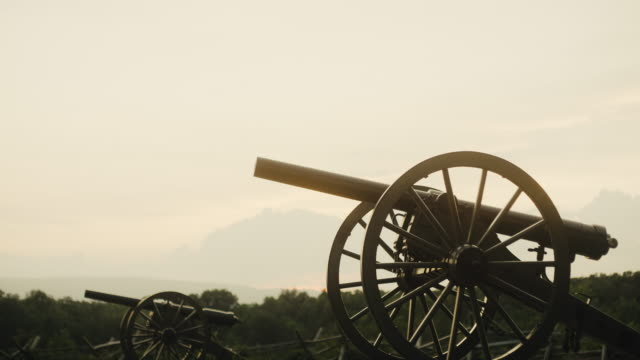 several us civil war cannons from gettysburg national military park, pennsylvania on a hazy day at sunset - cannon stock videos & royalty-free footage