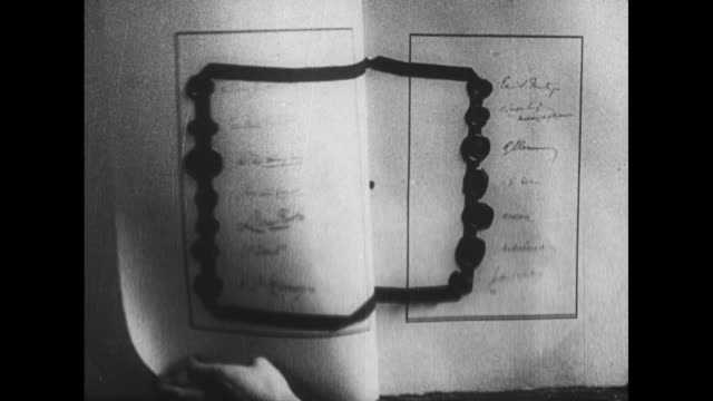 several views of the actual treaty of versailles with numerous signatures sealing wax and ribbon / note exact day not known - seal stamp stock videos and b-roll footage