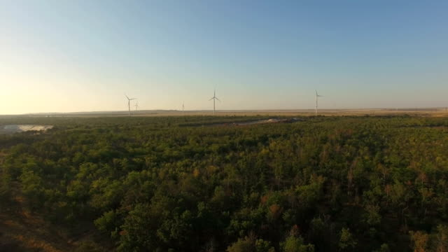 aerial: several wind turbines on blue sky background - electrical equipment stock videos & royalty-free footage