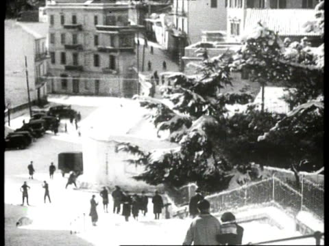 vidéos et rushes de several winter locations in europe children playing in snow / barcelona spain and tirol austria - 1934