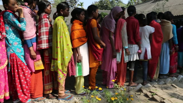 several women are waiting to receive medicine in a hospital in bagdogra. the hospice is located in the north-east of india near the city of bagdogra.... - luoghi geografici video stock e b–roll