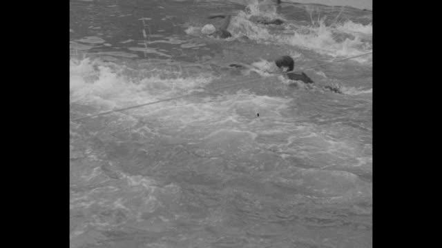 vídeos de stock e filmes b-roll de several women swimmers swim laps in amateur 220yard race / sot race official congratulates winner helene madison on lowering world record sot madison... - baixar