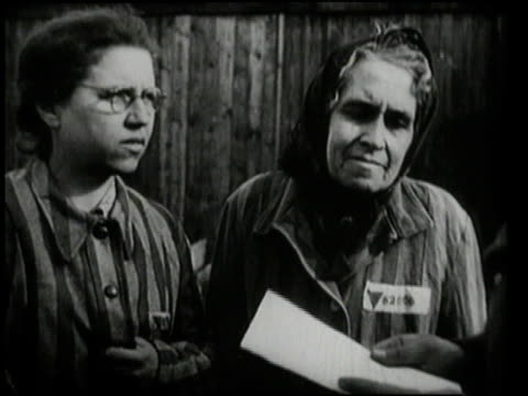 several women talking to guard and reading from piece of paper / oswiecim, germany - poland stock videos & royalty-free footage