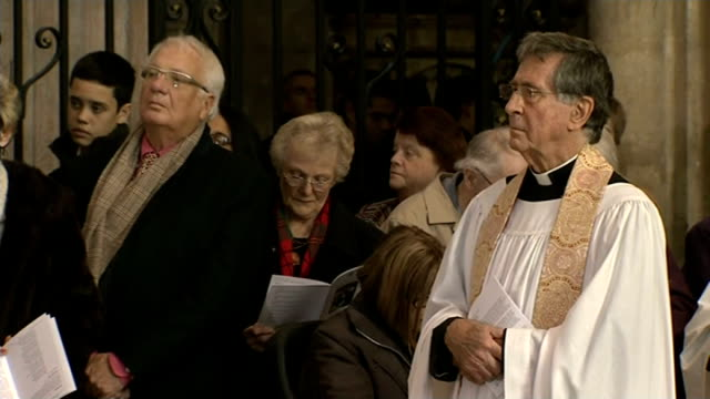 severe cold prevents archbishop of canterbury conducting the christmas service; various shots people in church listening during service - archbishop of canterbury stock videos & royalty-free footage