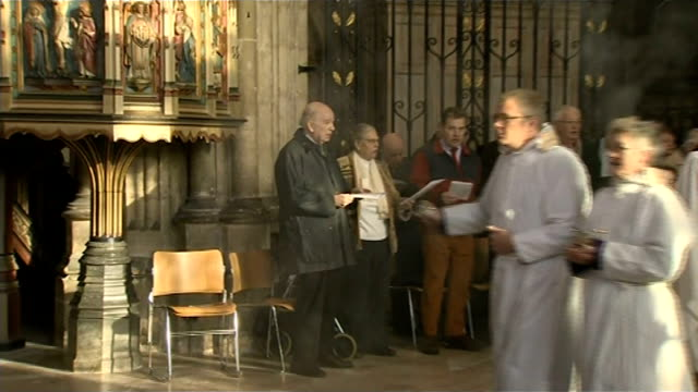 severe cold prevents archbishop of canterbury conducting the christmas service; church clergy along down aisle with candles and swinging incense... - archbishop of canterbury stock videos & royalty-free footage