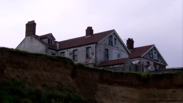 severe erosion encroaches on beach-front property in england. available in hd. - coastal feature stock videos & royalty-free footage