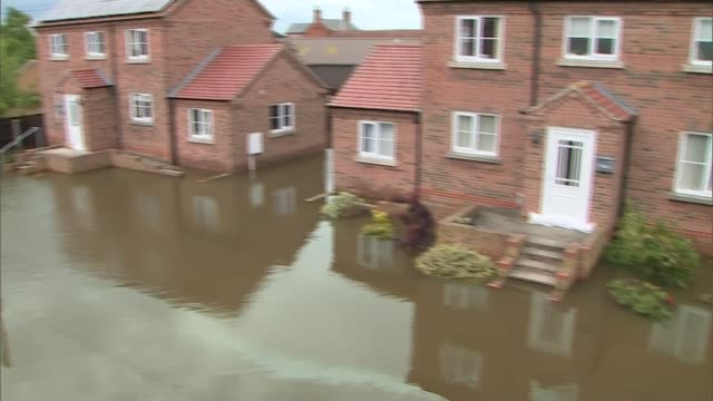 severe flooding forces evacuation in wainfleet lincolnshire england lincolnshire wainfleet ext floodwater surrounding houses - lincolnshire stock videos & royalty-free footage