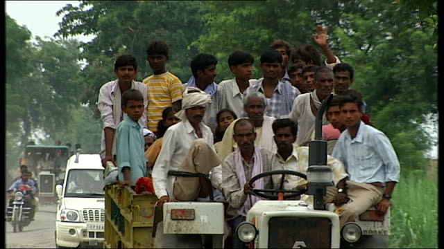 shots of local people coping in uttar pradesh various shots of tractor carrying group of people along country road various shots of damaged flooded... - uttar pradesh stock videos & royalty-free footage