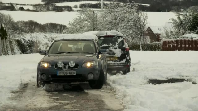 Severe gales and snow batter Britain and continental Europe ENGLAND County Durham Cars struggling to move in snow Car with damaged bonnet on side of...