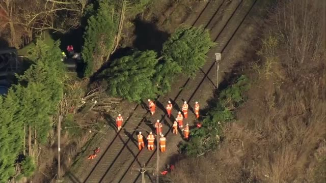 Severe gales and snow batter Britain and continental Europe Norfolk Norwich Trees fallen onto train tracks with workers surrounding AIR VIEWS /...