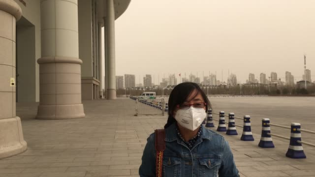 severe sand storms and heavy haze attacked a larger area of northern china beijing and tianjin have released the highest level warning of air... - air pollution stock videos & royalty-free footage