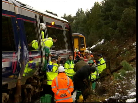severe snow conditions around britain partially derailed train on snowcovered tracks emergency workers and engineers at side of train helping... - hovering stock videos & royalty-free footage