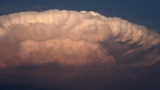 Severe thunderstorm with developing back-anvil cloud and knuckles.