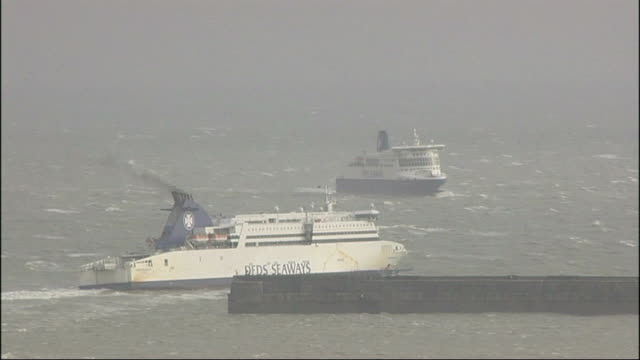 severe weather causes transport chaos and claims lives kent dover ext ferries along near coast long shot lorries at dover port ferry in rough seas - ferry stock videos & royalty-free footage