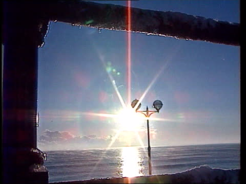 severe winter weather c4n yorks bridlington gv snow covered cliffs pull out ditto and lamp posts on promenade gv thick snow on promenade with... - bridlington stock-videos und b-roll-filmmaterial
