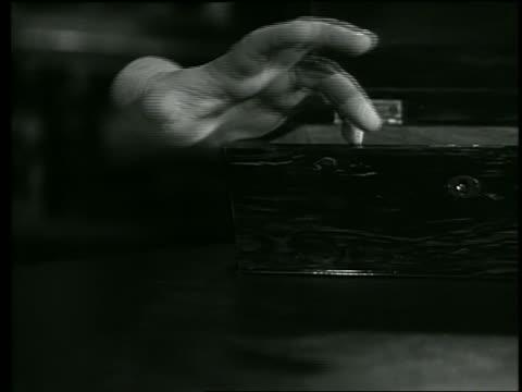 b/w severed hand moving fingers - horror movie stock-videos und b-roll-filmmaterial