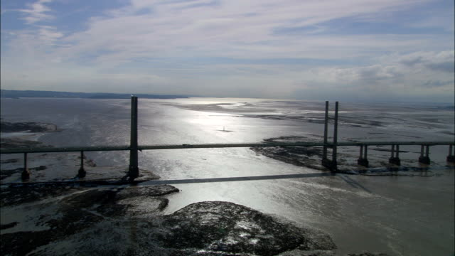 severn bridge - aerial view - england, gloucestershire, forest of dean, united kingdom - estuary stock videos & royalty-free footage