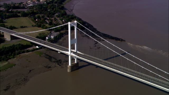 severn road bridge - aerial view - wales, monmouthshire, united kingdom - river severn stock videos & royalty-free footage