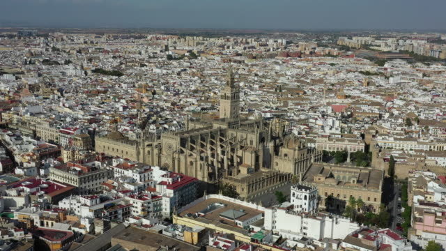 sevilla cathedral and nearby cityscape / seville, spain - cathedral stock videos & royalty-free footage