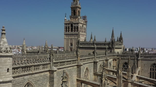 sevilla cathedral / seville, spain - kirchturmspitze stock-videos und b-roll-filmmaterial