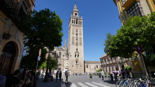 seville giralda tower beyond plaza - circa 12th century stock videos and b-roll footage