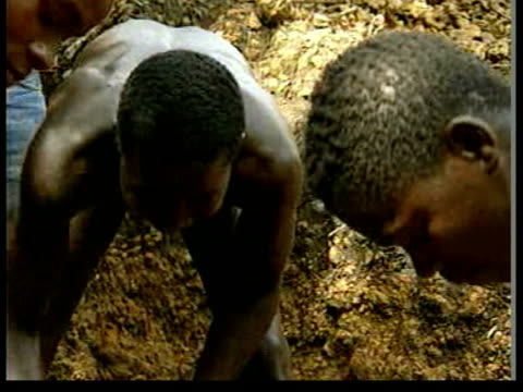 man along river in canoe ls man across river men sifting for diamonds men digging in search of diamonds man searching for diamonds man interviewed... - sierra leone stock videos & royalty-free footage