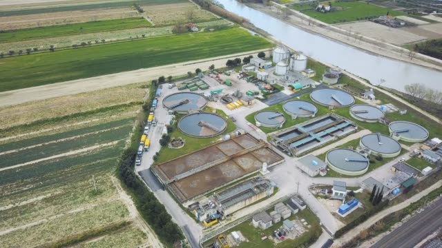 sewage treatment factory in italy - aerial view - water pollution stock videos & royalty-free footage