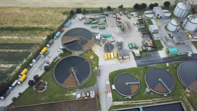 sewage treatment factory in italy - aerial view - biologia video stock e b–roll