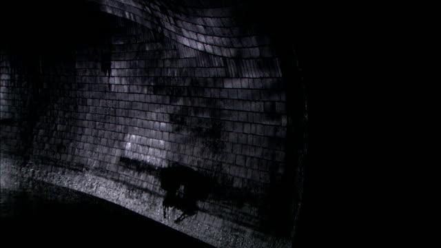 sewer water reflects on a stone wall. - 反射点の映像素材/bロール