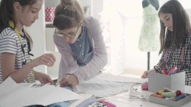 sewing class for kids. - sewing stock videos & royalty-free footage