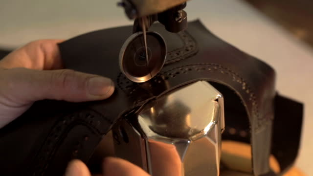 sewing easy and carefully - leather stock videos & royalty-free footage