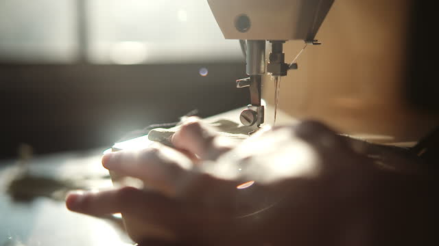 sewing fabrics in the sunlight - human limb stock videos & royalty-free footage
