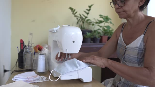 sewing face mask during the coronavirus pandemic - mesquita stock videos & royalty-free footage