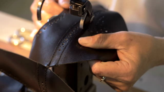 sewing in progress - leather shoe stock videos and b-roll footage