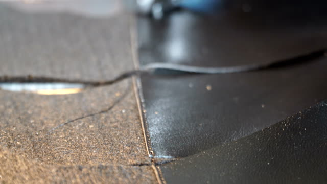 sewing leather - sewing machine embroider on the leather - making leather shoes