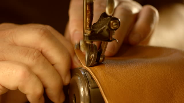 sewing leather - craftsperson stock videos and b-roll footage