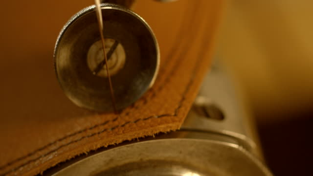 sewing leather - sewing machine stock videos & royalty-free footage