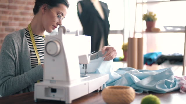 stockvideo's en b-roll-footage met sewing machine/ debica/ poland - kleermaakster