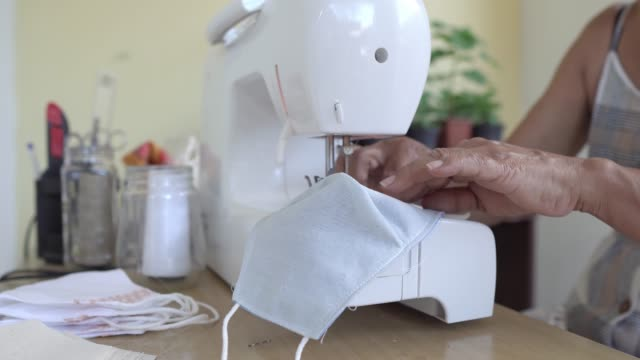 sewing machine during pandemic - mesquita stock videos & royalty-free footage