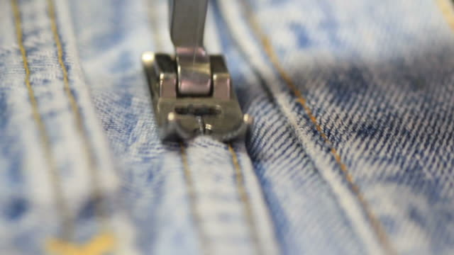 sewing machine jeans - jeans stock videos & royalty-free footage