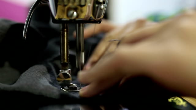 sewing machines making clothes - cucire video stock e b–roll