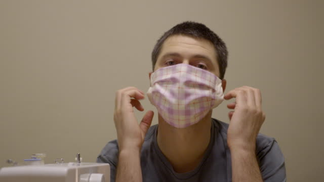 sewing medical masks for hospitals at coronavirus pandemic time. - prevention stock videos & royalty-free footage