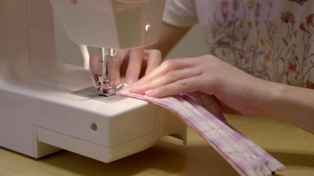 sewing medical masks for hospitals at coronavirus pandemic time. - sewing stock videos & royalty-free footage