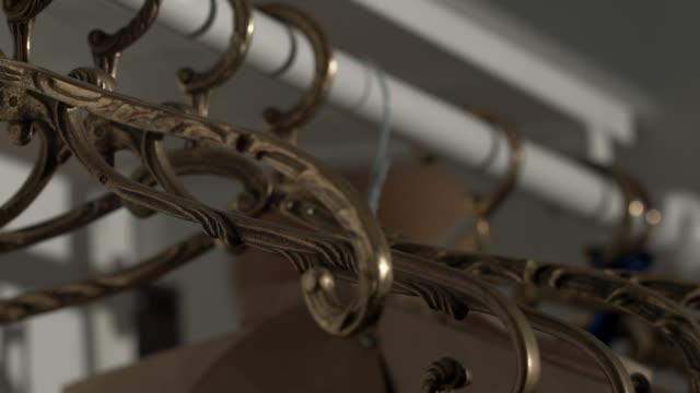 sewing patterns hanging in designer workshop - パタンナー点の映像素材/bロール