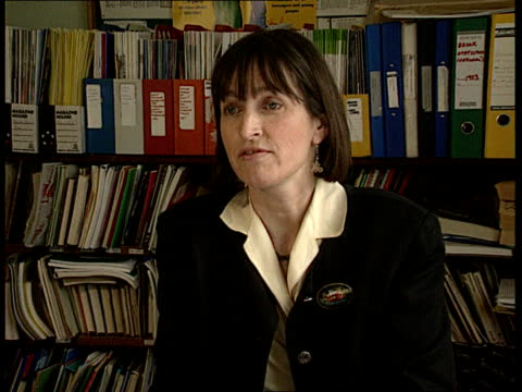 sex education booklet int london se17 cms alison hadley sitting at desk looking at booklet tcbv ditto cms alison hadley intvw sot moral confusion is... - sex education stock videos & royalty-free footage