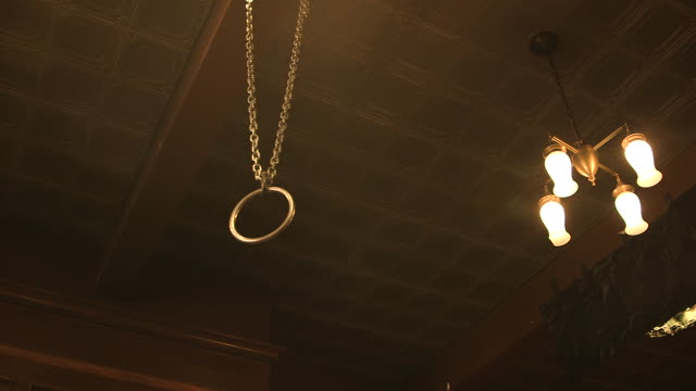 sex ring hangs from ceiling, low angle - domestic room stock videos & royalty-free footage