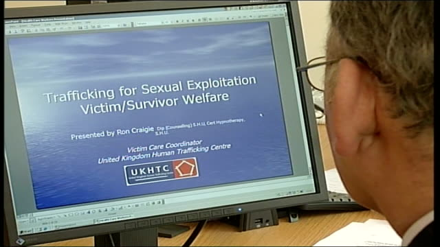 police launch uk human trafficking centre sheffield back view of man looking at computer monitor - human trafficking stock videos and b-roll footage